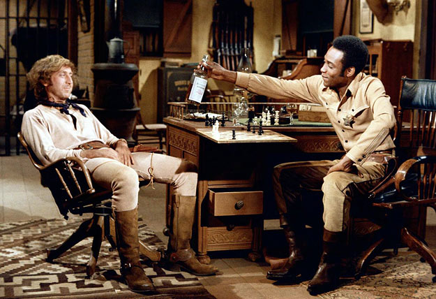 "Gene Wilder and Cleavon Little as Jim ""the Waco Kid"" and Sheriff Bart in Mel Brooks' Blazing Saddles (1974)."